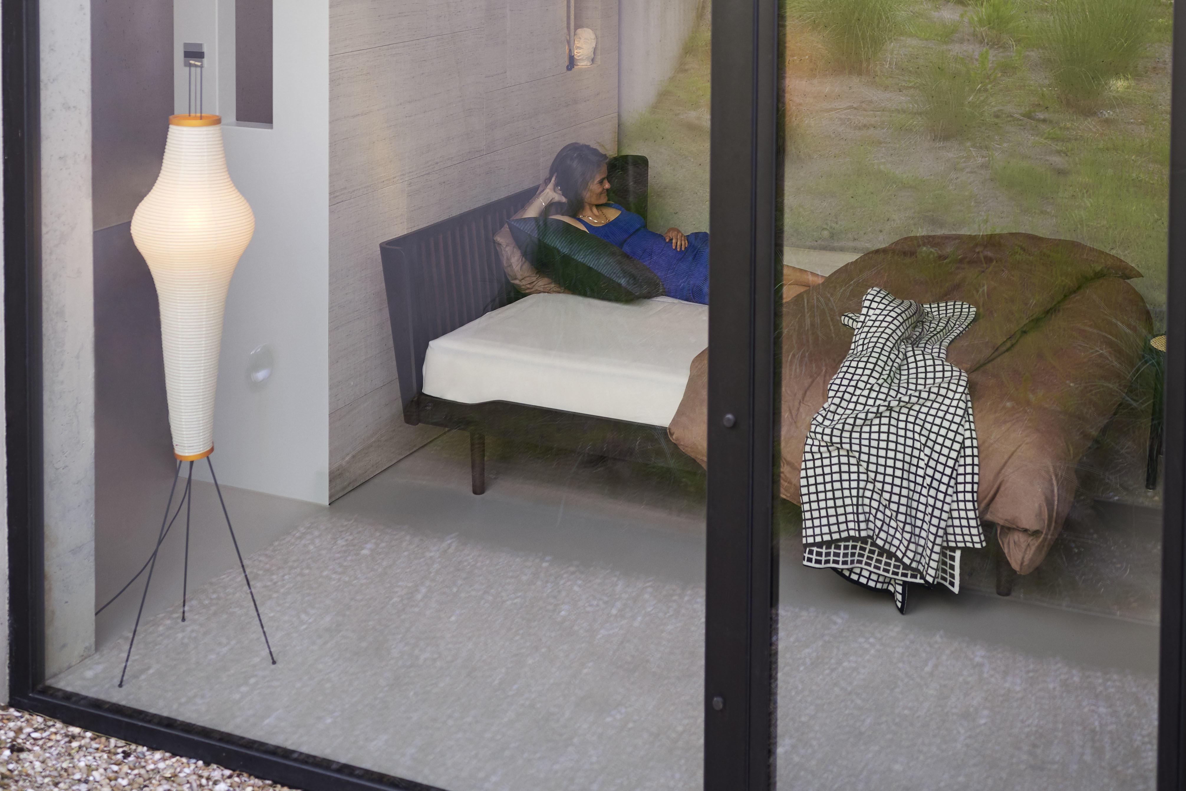 woman sleeps in brown noa bed