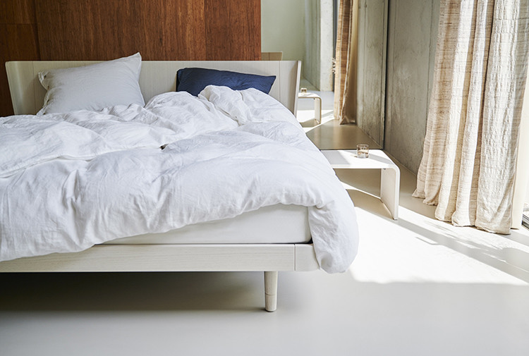 sustainable wooden noa bed with with duvet cover